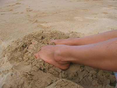 Feet in beach sand
