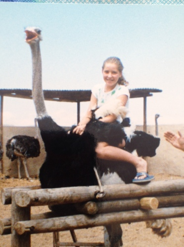 The same trip where I sat on an ostrich. This photo was taken 3 seconds before the bird turned around and pecked me so hard I cried in front of all my school mates.